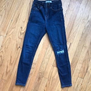 High rise skinny jeans with knee distress